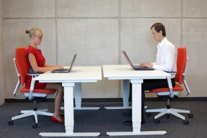 man and lady sitting at desks